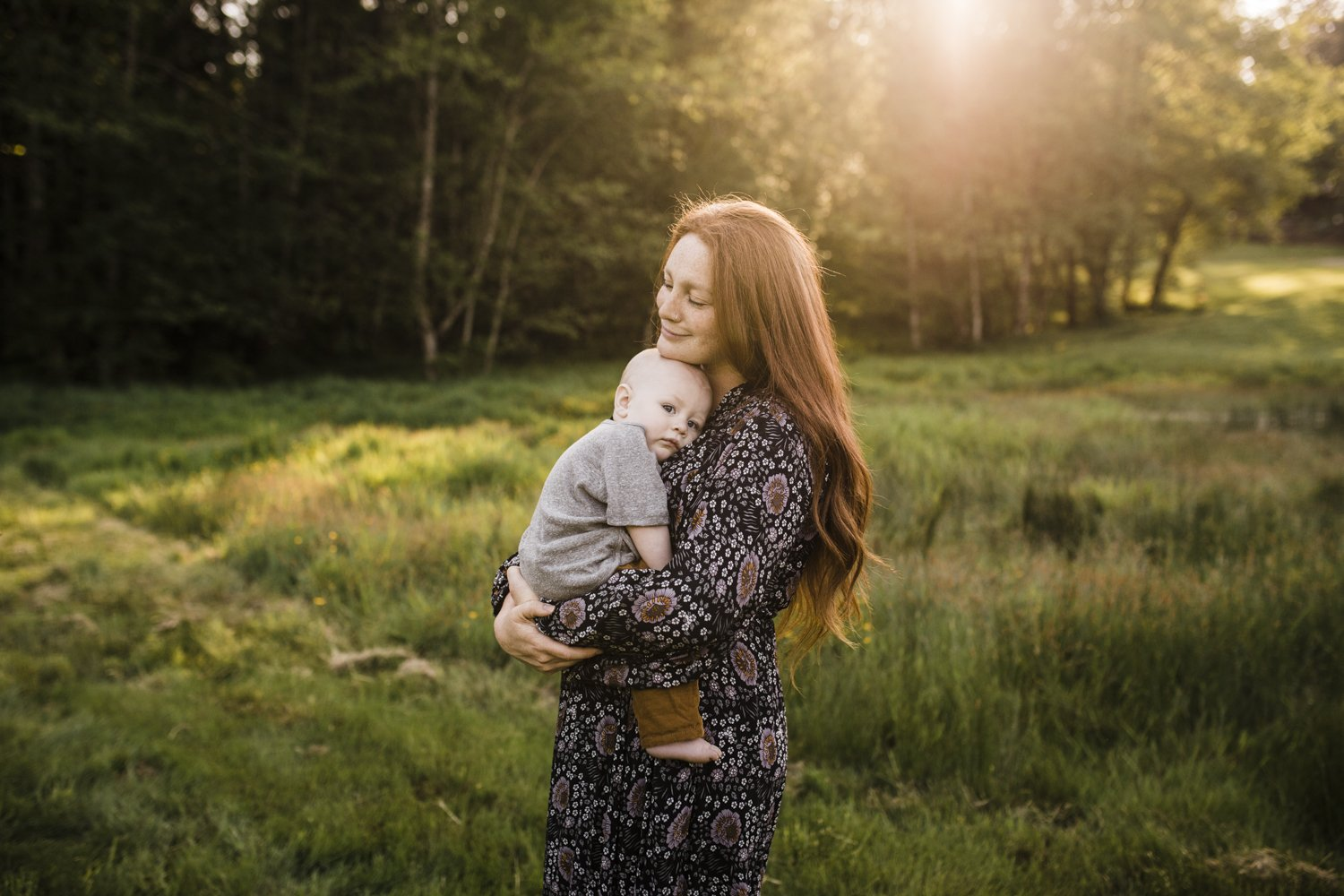 mother holding child golden light