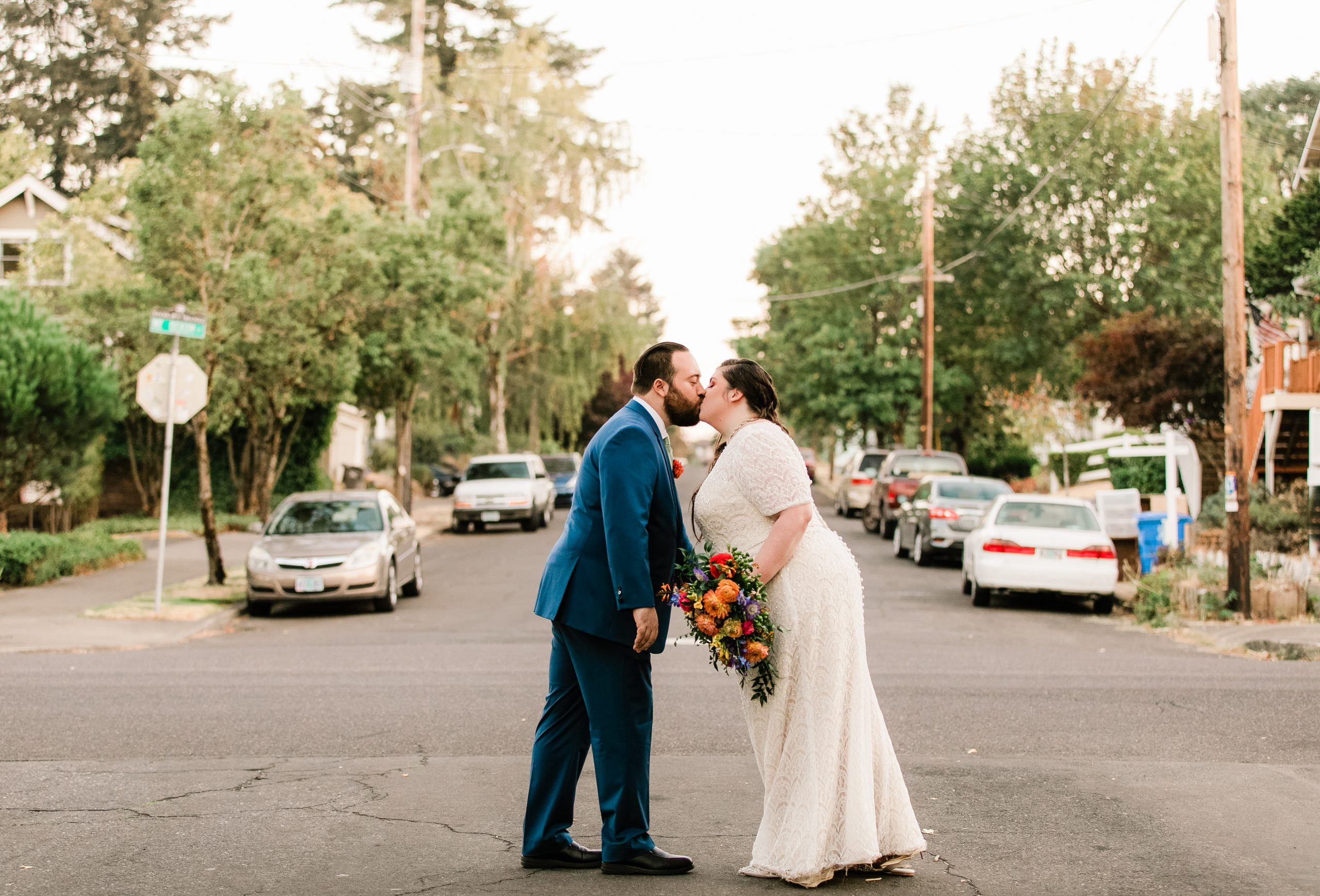 village ballroom ne portland wedding couple kissing in street